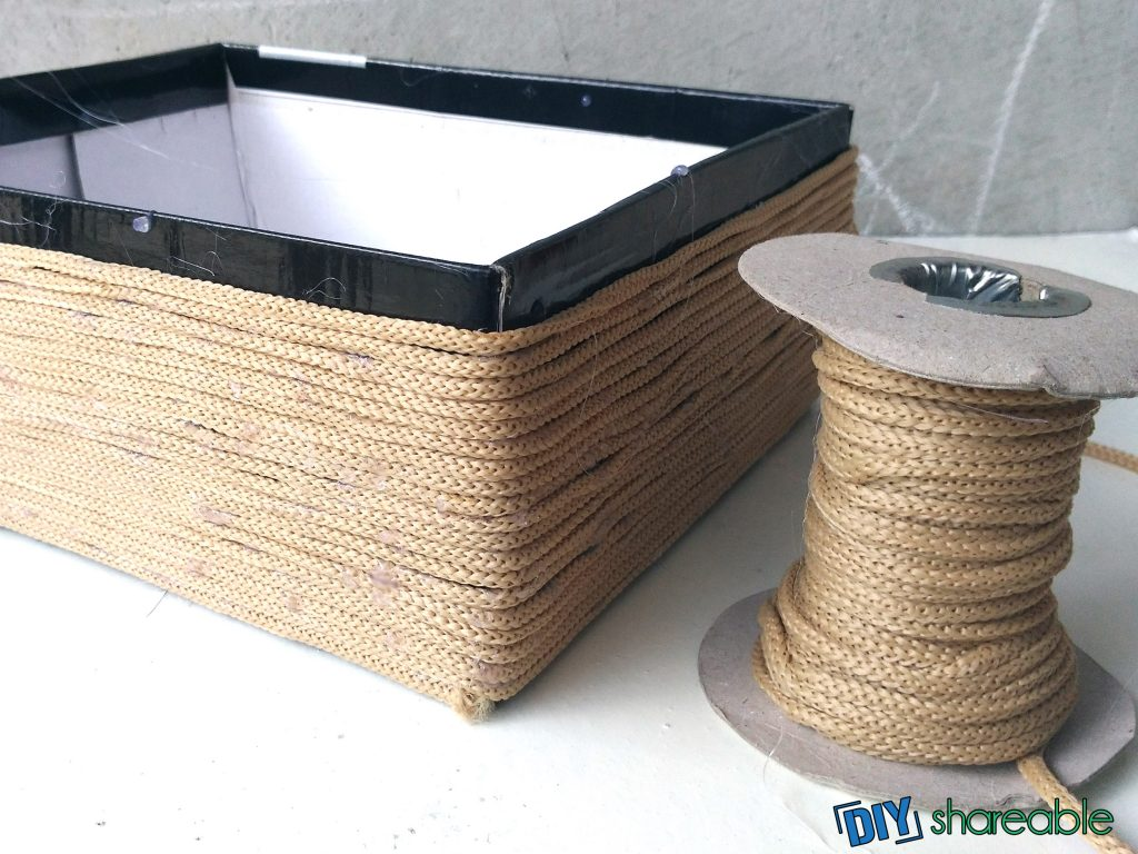 glue and wrap cord around box until you get to the top of the DIY Storage Basket