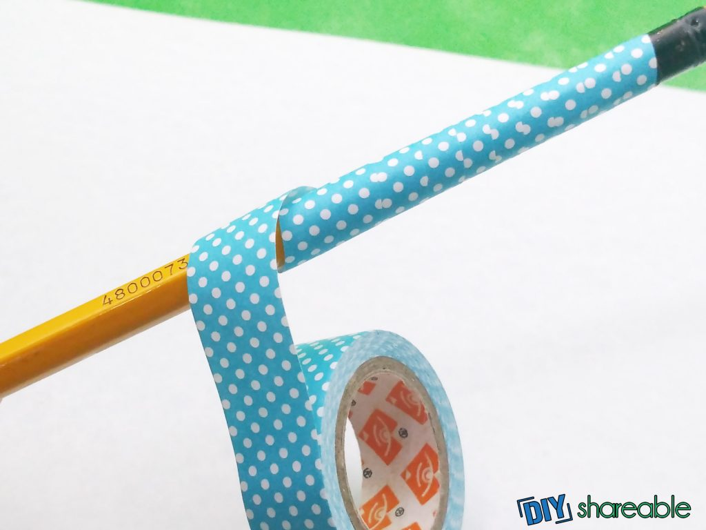 continue wrapping penci in paper tape to create DIY personalized pencils