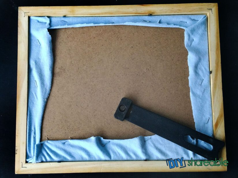 place board inside and trip any excess fabric to help fit in frame
