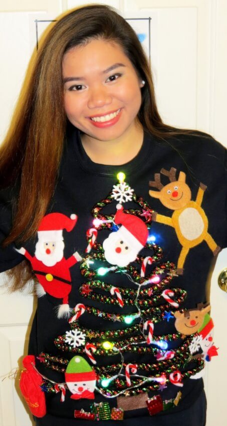 This idea for a ugly sweater incorporates everything holiday icon at once.