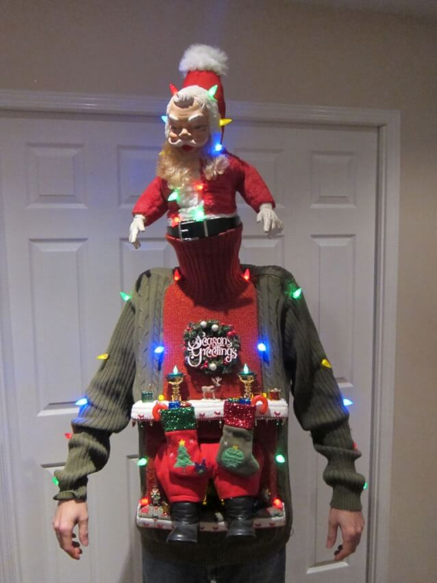 Very creative ugly sweater idea shows that Santa Claus is stuck in the chimney.
