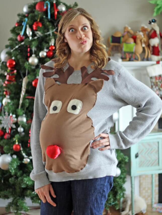 Pregnant woman incorporates her baby bump into her ugly sweater idea.
