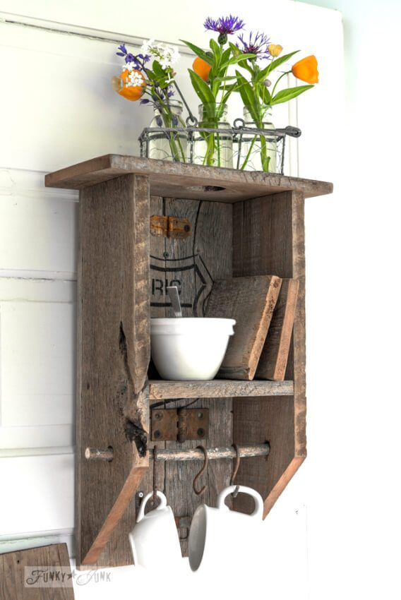 DIY reclaimed wood shelf provides decorative sufaces and other functionality in a small half bath.
