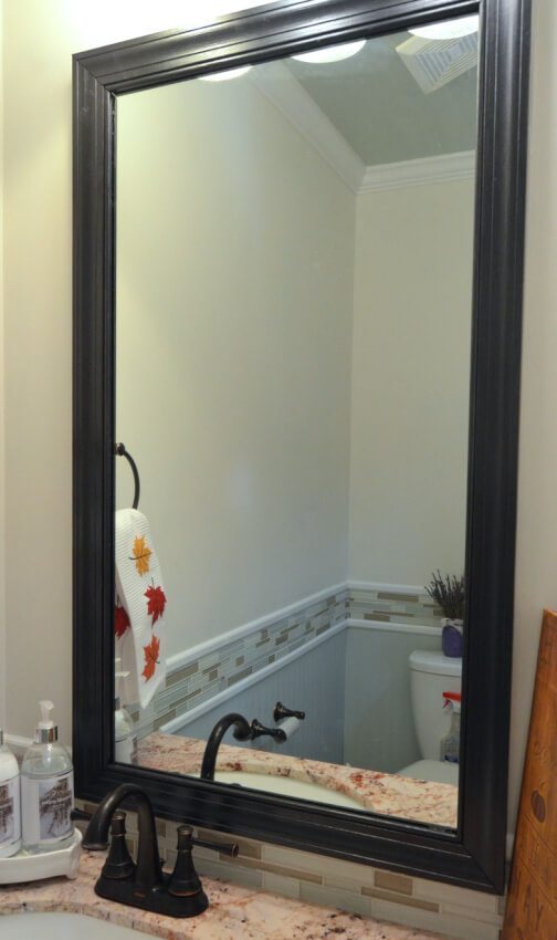An ordinary mirror transformed by enclosing it with a dark, classic frame.