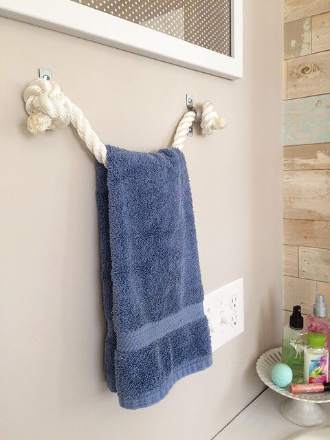 Decorative rope towel holder keeps towels accessible but out of the way.