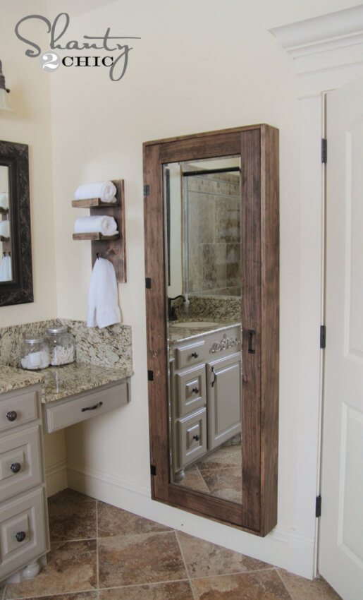 Rustic, wooden storage case with full mirror provides needed storage and a unique feature.