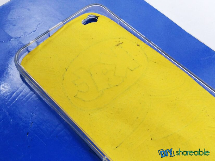 lay design in phone case once ink has dried
