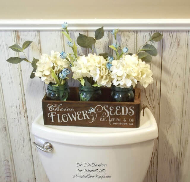 This antique sewing drawer seed box dresses up a space that every single bathroom has.