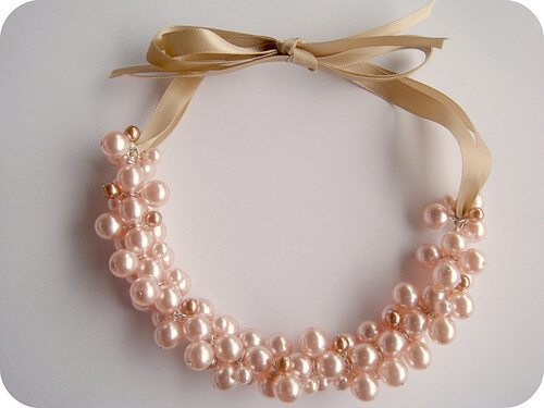 pearl cluster necklace tied with gold ribbon