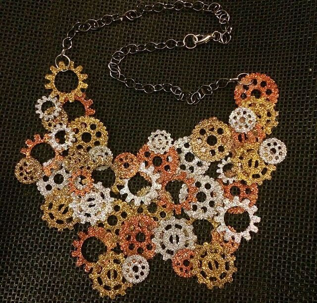 statement necklace made from gears and glitter