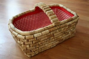 Wine cork covered basket with red gingham lining.