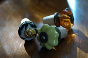 Wine cork bottle stopper with glass top.