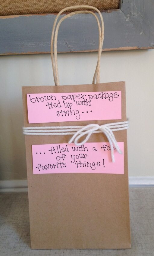 This DIY gift uses a brown paper bag to create a package full of your boyfriend's favorite things.