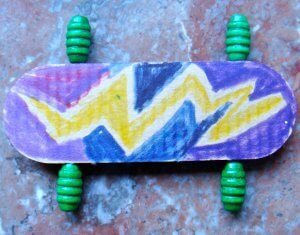 purple popsicle stick skateboard with yellow lightning bolt