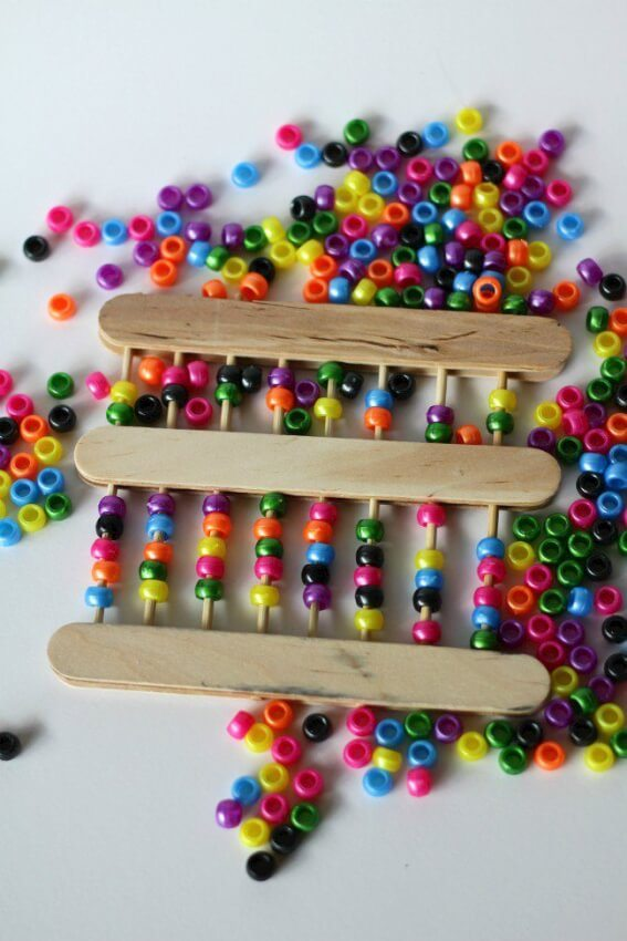 popsicle stick abacus with colored beads