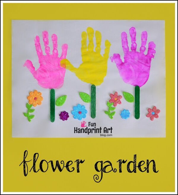 handprint flowers with pink and yellow and green popsicle stick stalks
