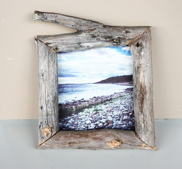 driftwood branch picture frame with photo of ocean