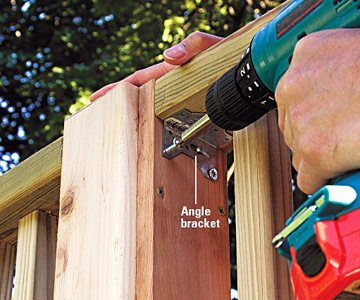 build wooden deck railing using green screwdriver