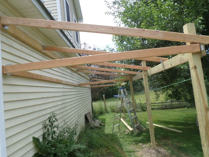Attach the 2x4 roof joists at 2 foot intervals on the wall side of the shed.