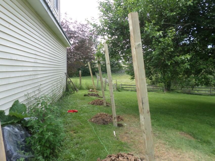 Dig, square, and level your shed posts