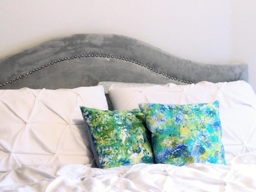 These DIY marbled pillows add a nice splash of color to the room decor.