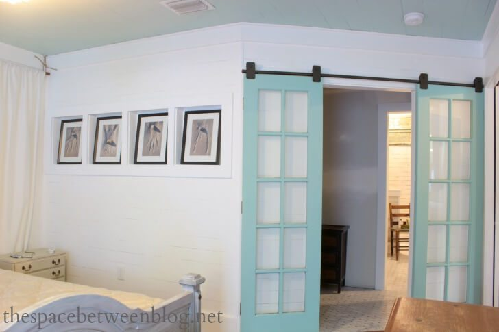 recycled french doors as sliding barn doors
