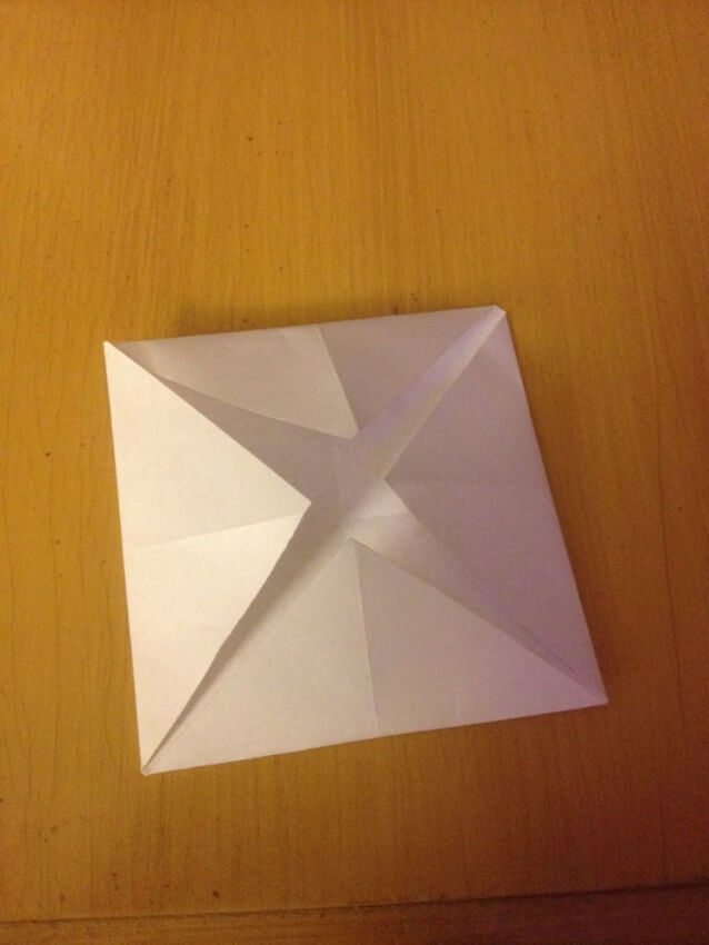 folding paper lantern in to middle