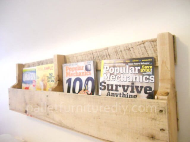 Wood pallet magazine rack keeps loose magazines and papers organized.