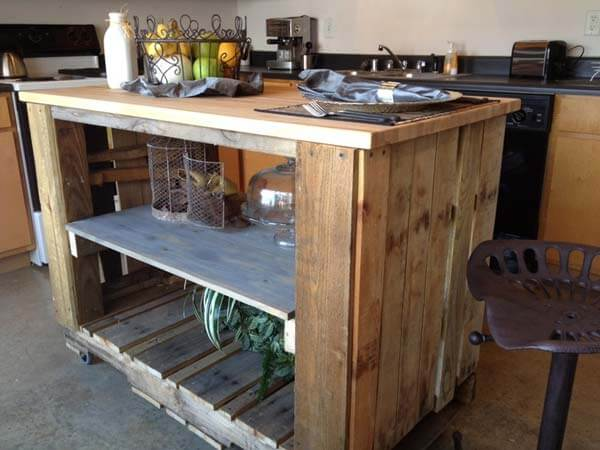 This kitchen island made from pallets provides a lot of extra workspace for prep and cooking.