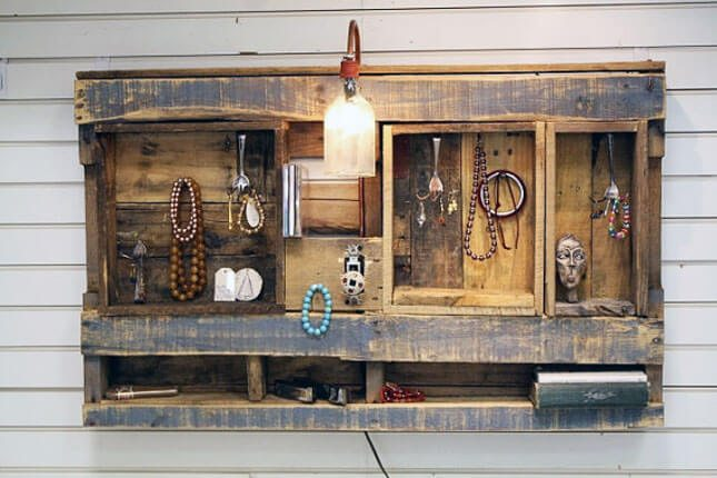 Amazing rustic pallet jewelry box showcases and organizes necklaces, bracelets, and other items.