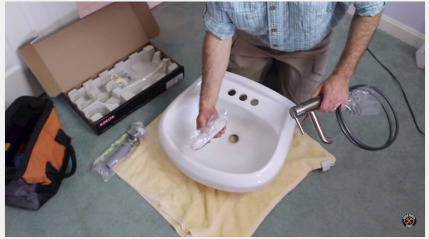Unpacking and setting up faucet assembly