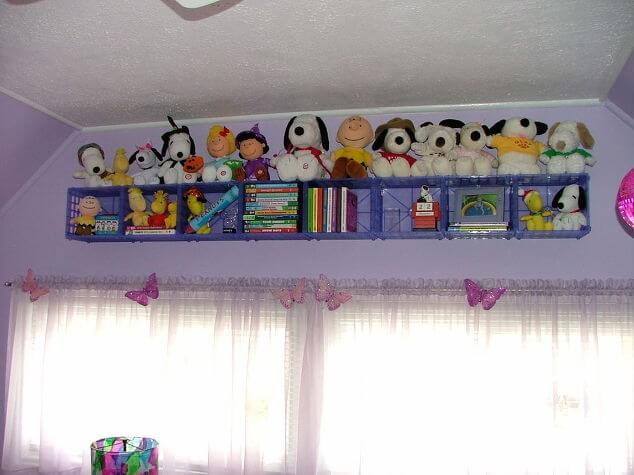 Make the most of underutilized space by attaching crates to the upper part of the wall for toys.