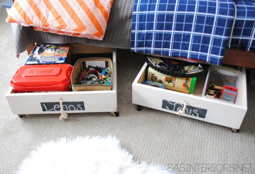 Under bed rolling drawers making great use of underutilized space and offering easy access.