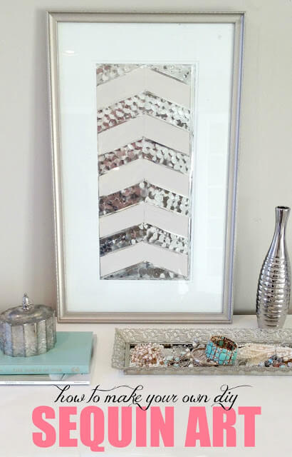silver sequin chevron art vanity table with silver vase and jewelry holder