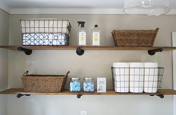 industrial laundry room shelving using pipes and boards
