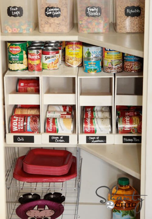 "These canned food organizers dispense your cans as needed and provide room on top for the ""one-off"" cans you may have."