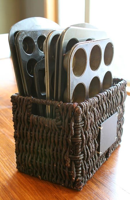 Pans that are often very awkward to store can be easily organized and accesible with a simple basket.