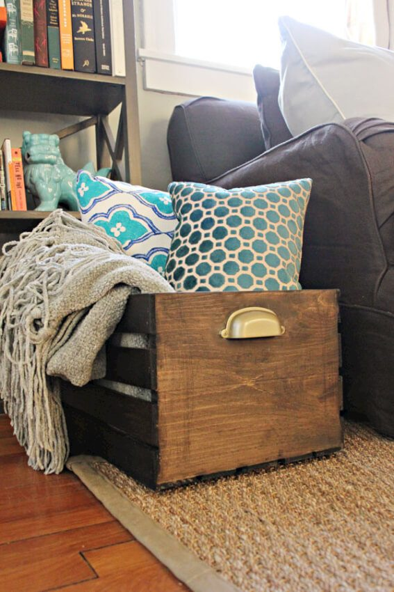 Very attractive storage box made out of old wooden crates and can be used to store just about anything.