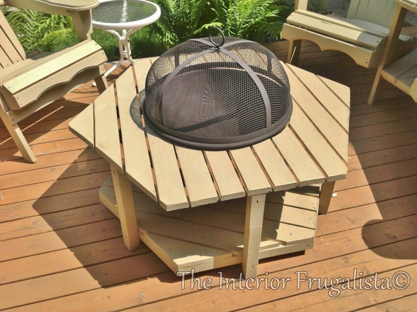 Very attractive adirondack fire bowl table surrounded by matching adirondack chairs, perfect for decks.